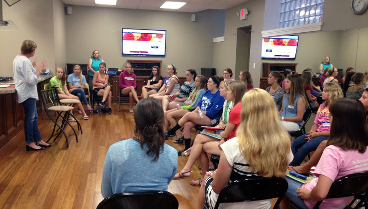 A group of high school girls listen to speakers at Grasso's summer leadership camp in Buffalo, NY.