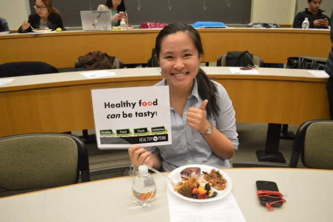 A student attends the Healthy Food Truck Initiative panel event in May 2014.