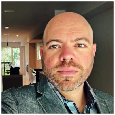 headshot of joey hundert wearing a casual blazer