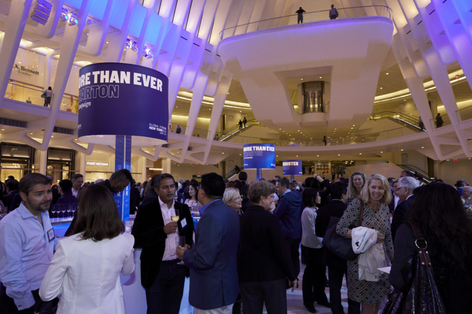 Wharton alumni networking at an event