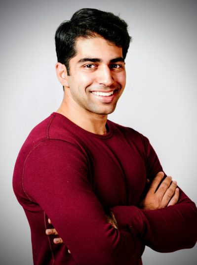 InnaMed cofounder anup singh posing for a headshot, arms crossed, wearing a dark red sweater