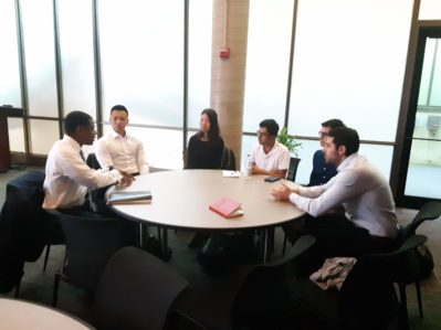 wiva students meeting with roy swan, sitting at a round table